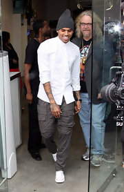 Chris Brown exited TAG Toy Store while wearing a pair of fitted gray cargos.