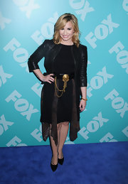 Demi Lovato rocked a black sheath dress that featured flowing panel inserts along the skirt.