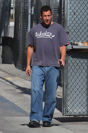 Adam Sandler paired his classic jeans with a navy T-shirt.