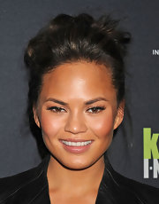 Chrissy Teigen wore her hair in a casual updo of pinned curls and loose wisps at the Editor at Large event in NYC.