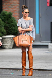 Chrissy Teigen looked sassy on the streets of New York City in camel-colored knee-high boots.