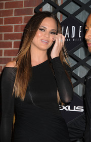 Chrissy Teigen wore her hair down and sleek straight for the Lexus Designed Disrupted Fashion event.