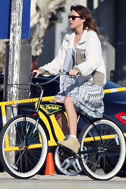 Christa Miller biked on the set of 'Cougar Town' in a summery dress and fleece jacket.