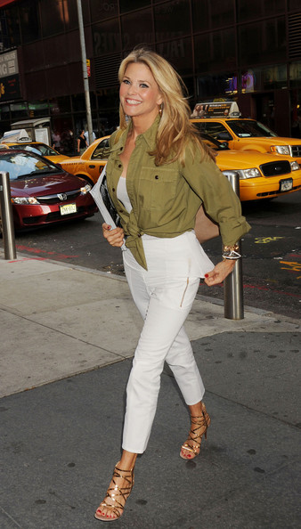 Christie Brinkley added sizzle to her step in NYC with a pair of super-strappy gold sandals.