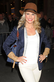 Christie Brinkley posed for a picture in Times Square sporting ruby red nails and matching lips
