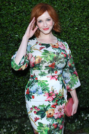 Christina Hendricks went all out with the colors during the Rape Foundation benefit, pairing a coral hard-case clutch with a floral outfit.