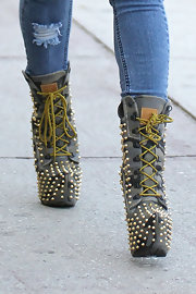 Christina turned heads in a pair of studded platform booties.