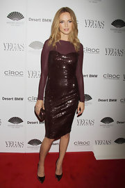 Heather Graham sparkled in this shimmery cocktail dress with long sheer sleeves.