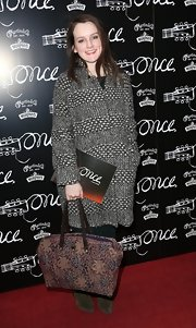 Sophie McShera chose a stylish black-and-white tweed coat for her red carpet look at the opening night of 'Once.'