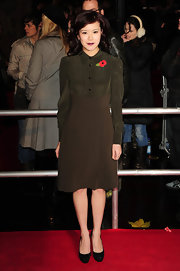 Katie Leung channeled the 1940's in an olive frock, dark lips and black suede platform pumps. Pinned back curls complete her transformation.