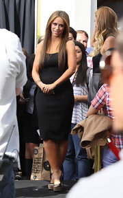 Jennifer Love Hewitt paired her black body con frock with lacy platform pumps.