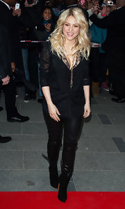 Shakira opted for a cool lace blazer to pair with her black tunic and leather pants at the launch of her 'S by Shakira' perfume.