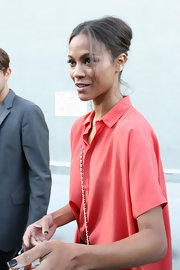 Zoe Saldana added elegance to her cool and casual denim ensemble with a classic chignon.
