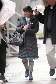 Lea Michele braved the rain in navy geometric print rain boots.