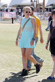 Busy Philipps wore her sheer neon mint dress over a retro Barbie bathing suit at Coachella.