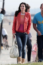 Courteney Cox looked bright and colorful in this red leather jacket, which she wore on the set of 'Cougar Town.'
