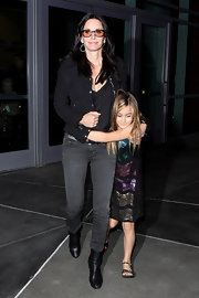Courteney topped off her look with black ankle boots.