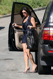 Courtney is seen flying solo without her current beau Mario Lopez. She hopped out of her SUV in a pair of killer peep-toe pumps. Which looked all too perfect with her navy romper.