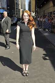 To add sizzle to her tea-length dress, Julianne Moore opted for a pair of black leather platform sandals. The T-strap heels were a spot on choice for her appearance on 'The Late Show with David Letterman.'