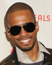Eric West opted for classic aviator shades for his red carpet look.
