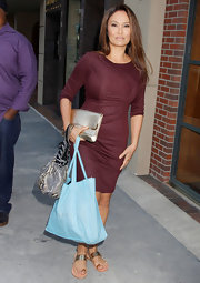 Tia Carrere was a little too overdressed in a maroon cocktail dress as she got a pedicure in Beverly Hills.