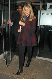 Holly Willoughby chose a red and blue plaid coat for a classically preppy look.