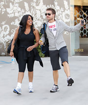 Comedian Niecy Nash wore a pair of white and blue running shoes.  These are the Under Armour Blacktip 2.
