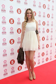 Zoe Salmon looked fun and flirty in a white baby doll dress and nude pumps.