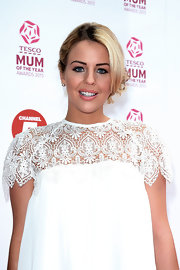 Lydia Rose Bright topped off her red carpet look with a soft and loose chignon.