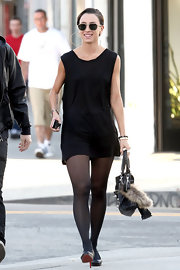 Medina wore a long black knit tunic for this dressed up day style.