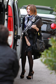 Much like her sister Danni Minogue is all for an amazing handbag. She toted a studded leather shoulder bag while out and about.