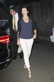 Dannii Minogue looked surprisingly summery in a pair of rolled white skinny jeans and metallic sandals.