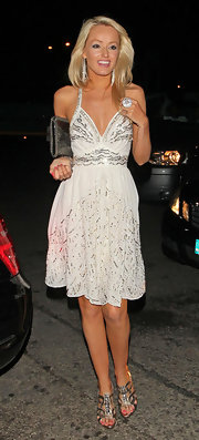 Hayley Roberts was all dolled up for a date night in a sequined white halter dress and strappy sandals.