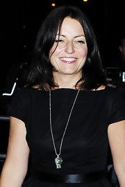 Davina McCall accessorized with a cute whistle pendant necklace during David Walliams and Lara Stone's wedding reception.