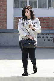 Demi Lovato opted for dark wash jeans to pair with her lighter denim jacket.
