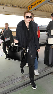 Demi kept her travel look casual and cool with an oversized black utility jacket.