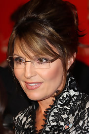 Sarah Palin showed up at the Time 100 event sporting her trademark french twist and rimless glasses.