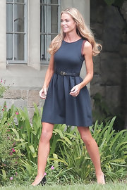 Denise Richards stepped out in a fitted A-line dress with a matching buckle belt.