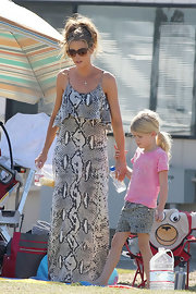 Denise Richards looked ultra-stylish at a soccer game in a snakeskin print maxi-dress.