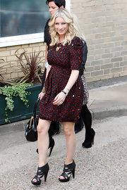 Denise van Outen donned a casual chic ensemble wearing a print dress teamed up with a pair of strappy black sandals.