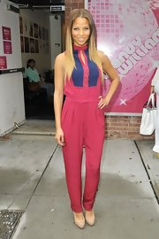 Denise Vasi was spotted wearing a candy-colored jumpsuit as she greeted her fans lined up outside a studio.