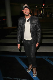 Maksim looks super tough in his skull baseball cap and motorcycle leather jacket.