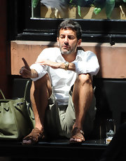 Marc Jacobs paired his cargo shorts and button down shirt with a army green Birkin bag.