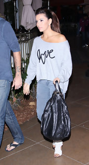 Eva Longoria sent a simple message with her slouchy off-the-shoulder Love sweater.