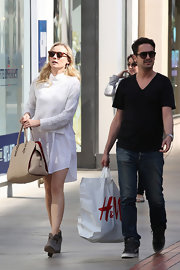 Diane Kruger opted for this white crewneck sweater to pair over her shirtdress for a casual but preppy daytime look.