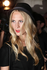 Poppy loves funky hats like this bowler she wore with bright red lips.