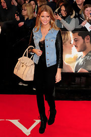 Millie Mackintosh created a contrast to her monochromatic outfit by carrying a pale pink ostrich embossed tote during the premiere of 'The Lucky One' in London.