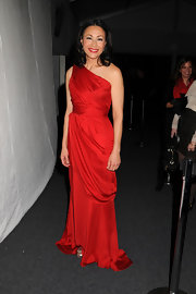 Ann Curry unleashed her inner diva in a red-hot draped one-shoulder gown at the 2011 Heart Truth fashion show.