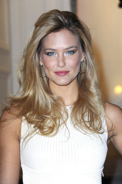 Bar Refaeli wore her golden hair swept back and in long loose waves at the Christian Dior fashion show in Paris.