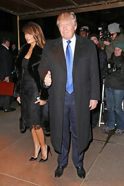 Donald Trump dressed up even his outerwear with this classic black wool coat.